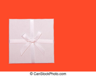 white gift box with ribbons on red background