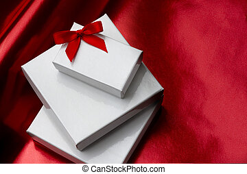 White gift boxes with red bow