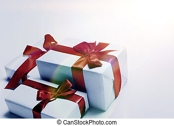 White gifts with red ribbon bow