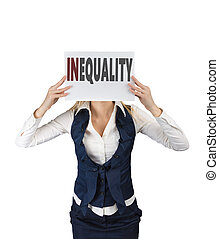 White girl holding a sheet of paper with word inequality, at face level