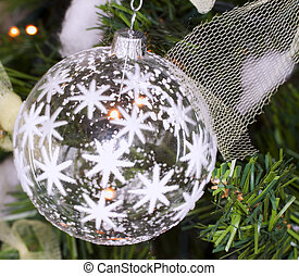 Christmas ball - White glass Christmas ball shot in a tree