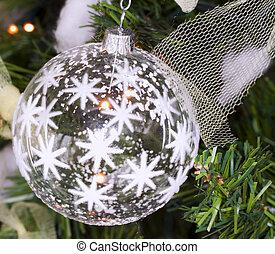Christmas ball - White glass Christmas ball shot in a tree