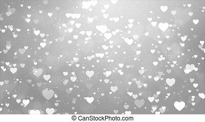 White Glitter Sparkling Magic light. Shining Dust Heart bokeh particles Loop background 4K.