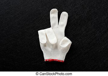 white glove with gesture of TWO on black background
