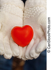 White gloves and red heart