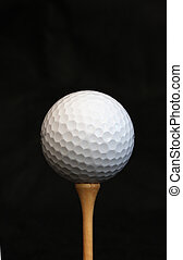 White golf ball on a tee