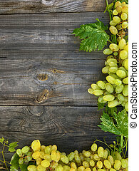 White grape on gray wooden background