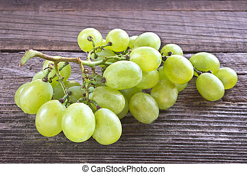 White grape on wooden background