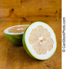 White grapefruit on wooden background