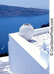 white greek pot on white terrace, Oia, Santorini, Cyclades,...