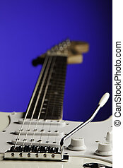 White Guitar Isolated On Blue