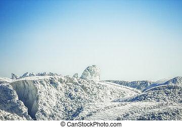 White gypsum mountain under the blue sky