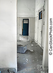 White hallway and doors in empty abandoned building.
