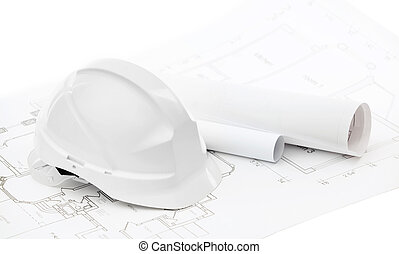 White hard hat near working drawings on white background