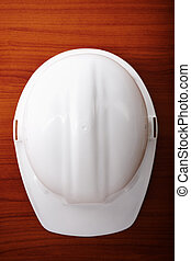 white hardhat - construction concept, selective focus on...