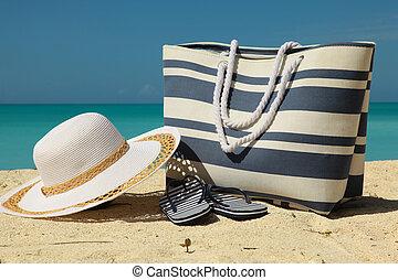 white hat and beach bag