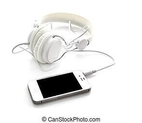 White headphones with mobile smartphone