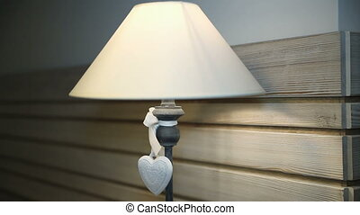 White heart on a floor lamp. Dolly shot