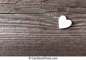 White heart on a wooden background with copy space