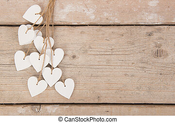 White hearts on a scaffolding wooden background with space for text