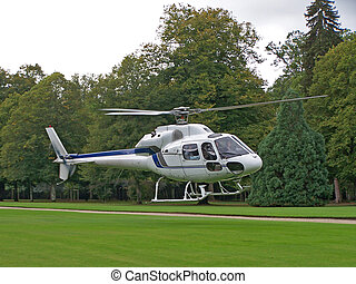 White Helicopter - A white helicopter on a field