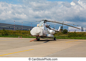 white helicopter on the platform airport in the sun in...