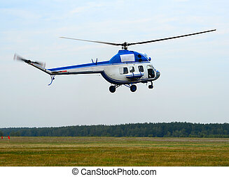 White helicopter on the way