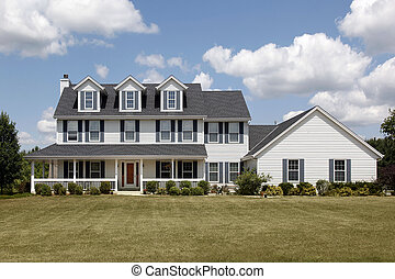 White home with large front yard