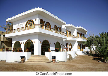 white hotel on the sea front in dahab, red sea, sinai, egypt