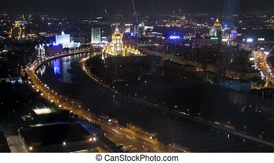 White house and hotel Ukraine stand in night city - MOSCOW -...