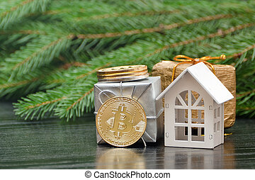 White house, coin Bitcoin and gifts on a background of fir branch