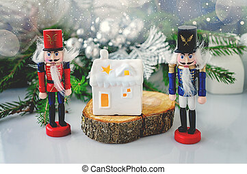 White house in the form of a ceramic candlestick on the background of decorative branches with a Nutcracker figure-Christmas card