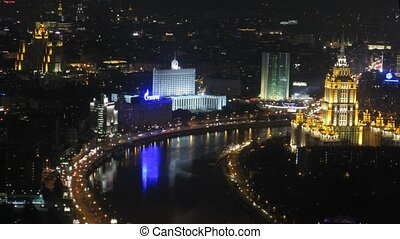 White house stand at night on river bank to the left of hotel Ukraina
