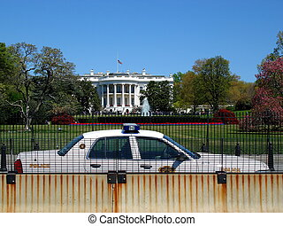 White House Under Siege - Police car and concrete barrier...