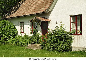 White houses and garden in Visby, the capital of Gotland,...