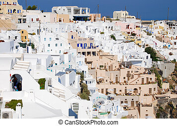 White houses at the edge of the cliff at the village of Oia in Santorini Greece.