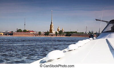 white hydrofoil vessel Meteor turns on Neva at Peter and Paul Fortress in St. Petersburg spring day