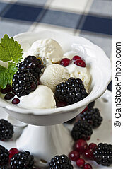 White ice-cream with berries and leaf of mint in white ...