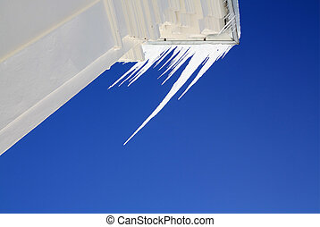 white icicles on blue background