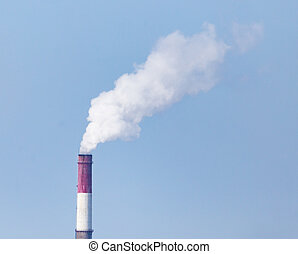 white industrial smoke from the chimney on a blue sky