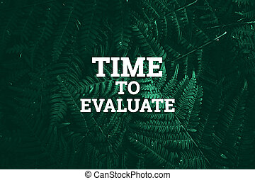 White inscription: time to evaluate, on a green natural background. Concept for motivating background, business, self-development.