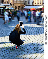 White Ipad, woman in black taking photos