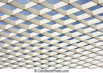 White Ironwork Pattern - A white geometric ironwork lattice...