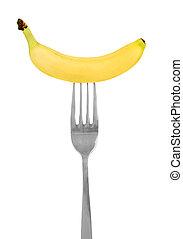 yellow banana on a fork