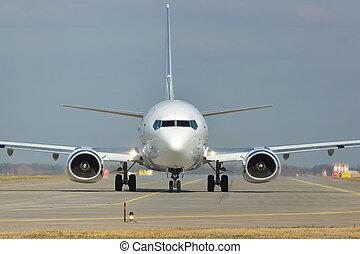White jet on runway