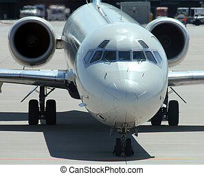 white jet plane approaching gate
