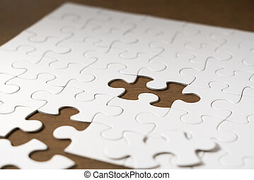 White jigsaw puzzle on the table.