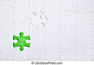 White jigsaw puzzle pattern backgroundClose up piece of white jigsaw puzzle with JOIN US text