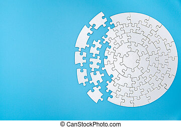 white jigsaw puzzle pieces on blue background