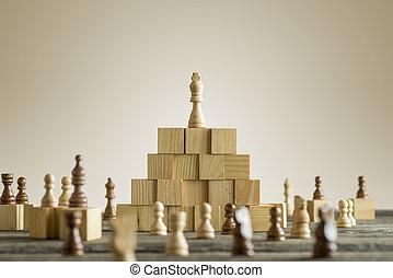 White king on wooden building blocks
